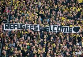 benvenuti rifugiati stadio